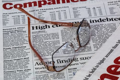newspaper spectacles glasses