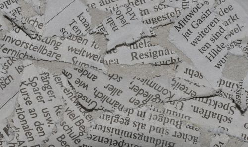 newspaper waste paper torn