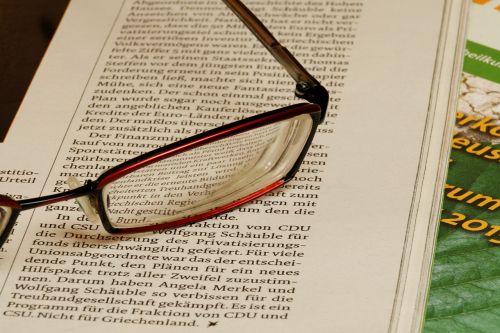 newspaper glasses read