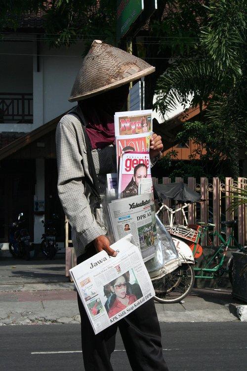 newspaper seller  indonesia  road