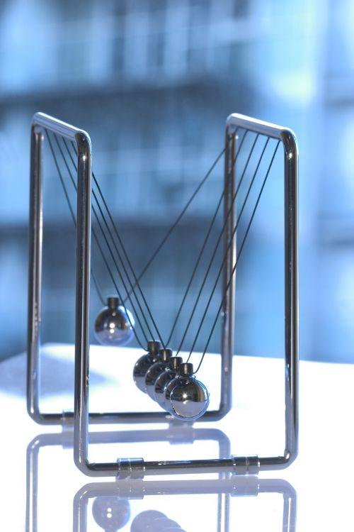 newton's cradle physics sphere