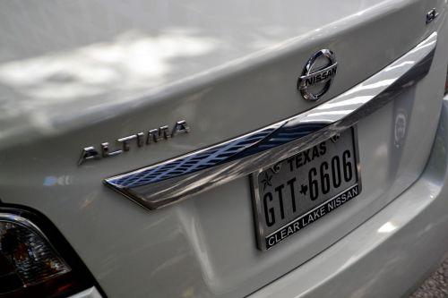 nissan altima white sedan car