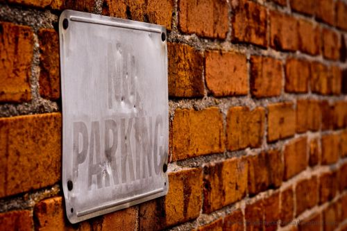 no parking sign brick