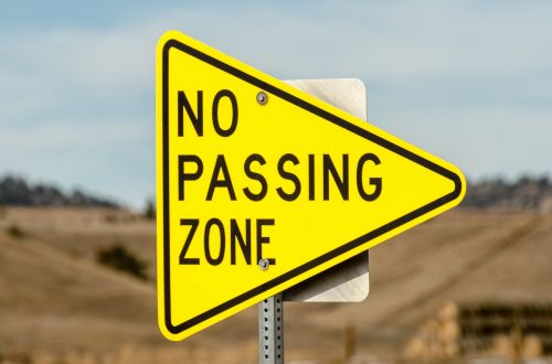 no passing zone sign triangle