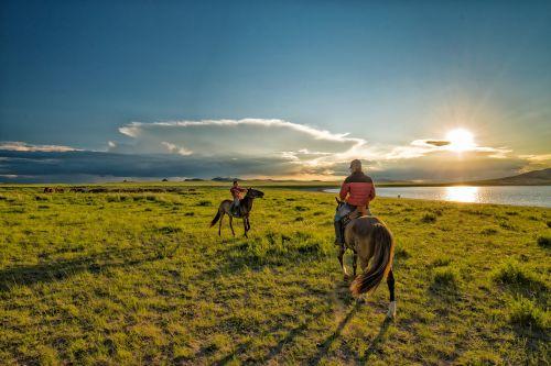 nomadic children sunset horse