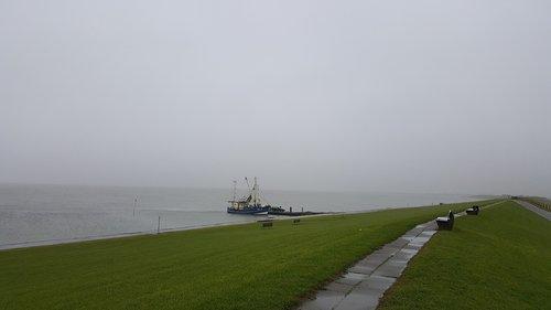 north sea  dam  fog