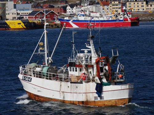 norwegian fishing boat heading out to sea calm sea