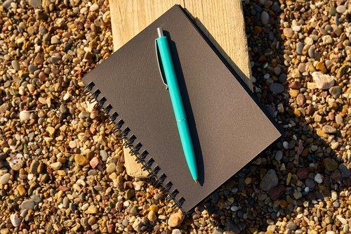 notebook  pen  black