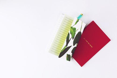 notebook  pen  white desk