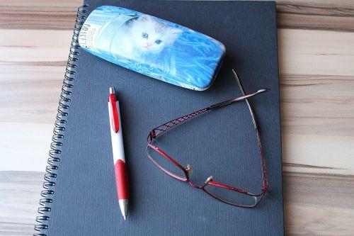 notebook pen workplace