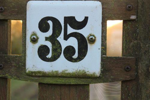number 35 enamel sign