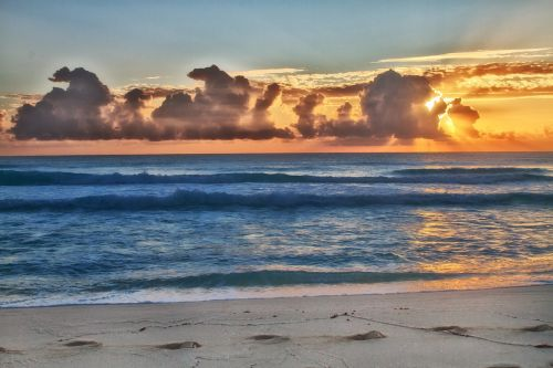 ocean,sea,beach,sand,sunset,blue,caribbean,sun,holiday,water,clouds,light,reflection,nature,sky