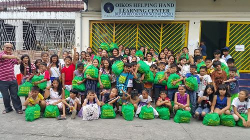 oikos helping hand philippines singapore
