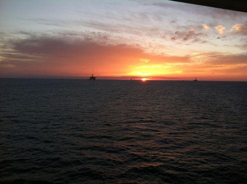 oil platform sunset vacation