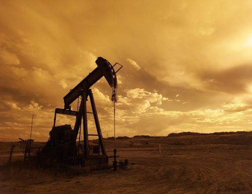 oil pump jack sunset clouds