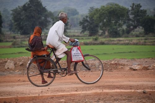 old couple bicycle travel