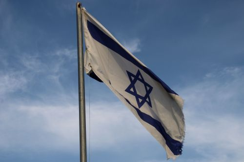 Old Israeli Flag Against Clouds