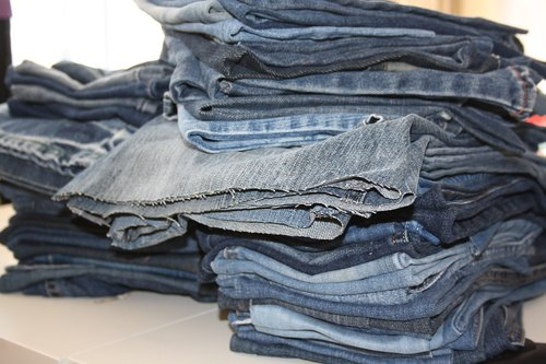 old jeans  pile of jeans  recycling