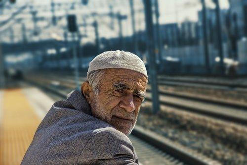 old man  hat  blazer