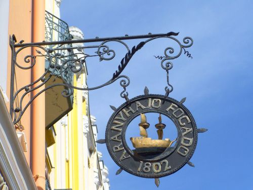 old signboard pecs king street
