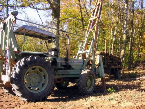 old tractor logging timber