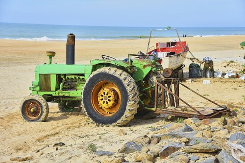old tractor  sea  towing