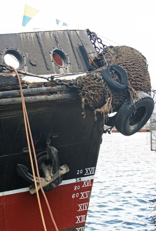 Old Tug Marked In Roman Numerals
