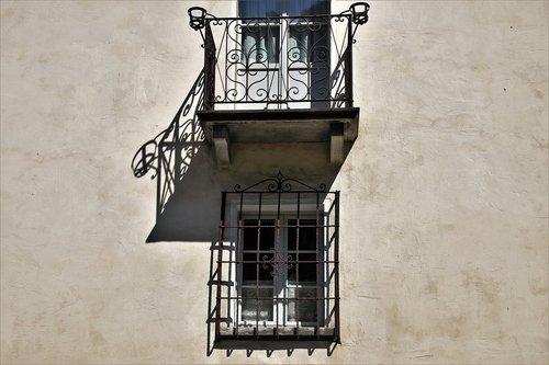 old windows  balcony  facade