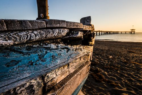 old wooden boat at sunrise wooden boat fishing boat