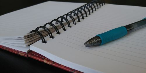 Open Notebook With Blue Pen