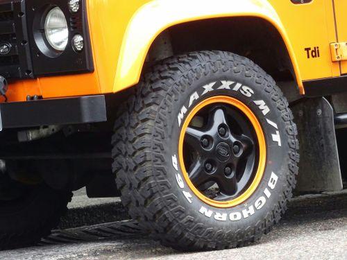 Orange Land Rover Jeep Front Wheel