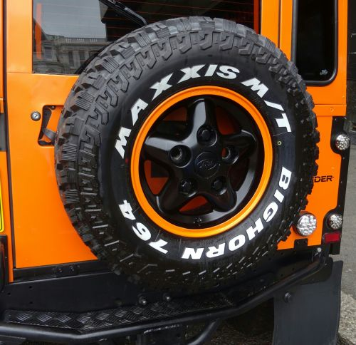 Orange Land Rover Jeep Spare Wheel