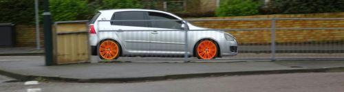 Orange Wheels Car On The Road