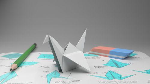 origami crane pencil to paper