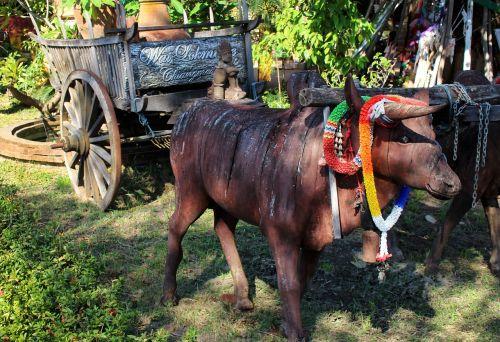 ox cart sculpture scene