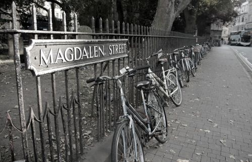 oxford,england,bicycles,black and white,british,iron,fence,city,street,english,uk,britain,historic,old,tourism,sidewalk,sign,europe
