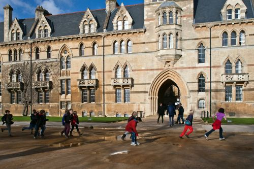 oxford,running,jumping puddles,school children,oxfordshire,architecture,university museum