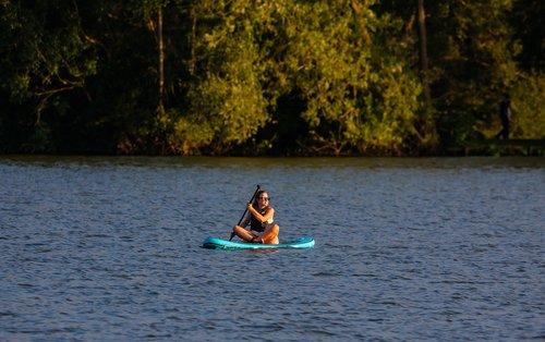 paddle board  woman on paddle board  woman on lake