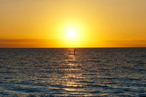 paddleboard sunset maui