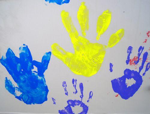 Paint-printed Hands Of Children