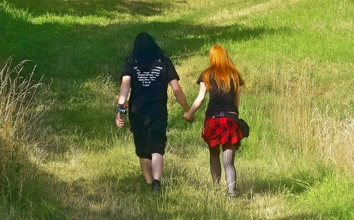 pair  holding hands  walk