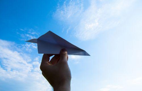 paper plane the hand sky