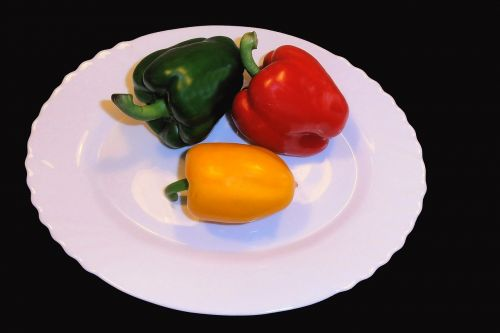 paprika,sweet peppers,red,yellow,green,black background,peppers,food,vegetables,eat