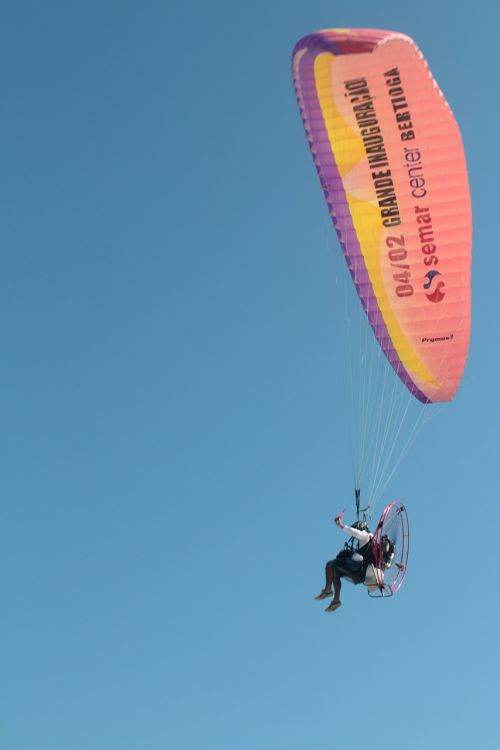 parachute motorised parachute walking in the air