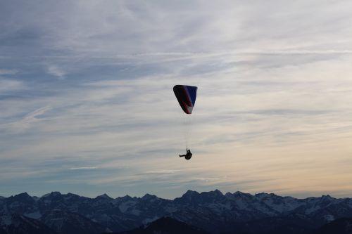 parachutist mountains parachute