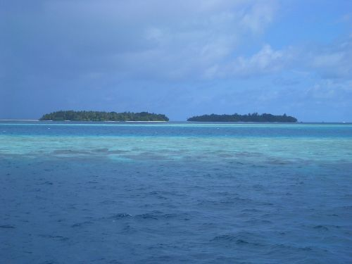 paradise blue sea clouds
