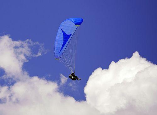paraglider blue-in-blue sky