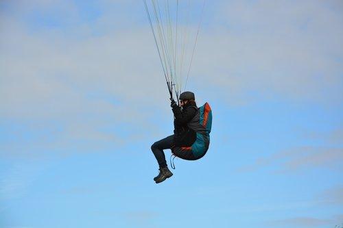 paraglider  paragliding  paraglider pilots sit harness