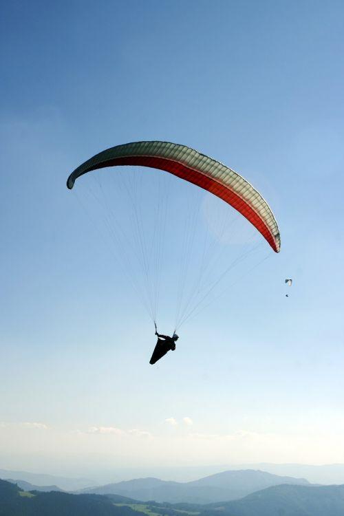 paragliding a parachute the sky