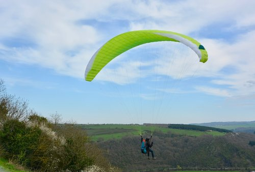 paragliding  take-off of a cliff  wing paraglider inflated